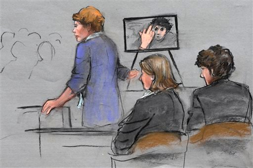 Courtroom sketch, prosecutor Nadine Pellegrini makes opening arguments during the first day of the penalty phase in the trial of Boston Marathon bomber Dzhokhar Tsarnaev, seated at right April 21, 2015. (AP Photo/Jane Flavell Collins)