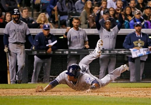 San Diego Padres' Yangervis Solarte slides safely into home against the Colorado Rockies during the eighth inning of a baseball game, Tuesday, April 21, 2015, in Denver. (AP Photo/Jack Dempsey)