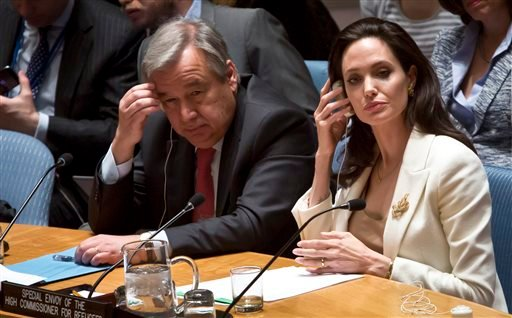 U.N. Special Envoy for Refugees and Hollywood star Angelina Jolie, right, and U.N. High Commissioner for Refugees António Guterres, left, brief the U.N. Security Council on Syria's refugee crisis, Friday, April 24, 2015.