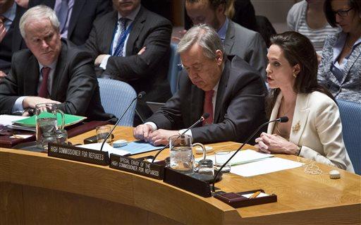 U.N. High Commissioner for Refugees António Guterres, center, and British U.N. ambassador Mark Grant, left, listens as U.N. Special Envoy for Refugees Angelina Jolie , right, brief the U.N. Security Council on Syria's refugee crisis.