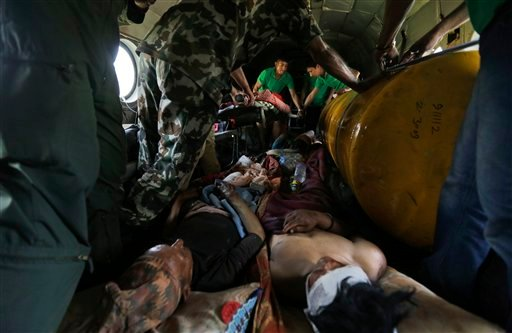 Nepalese victims of Saturday's earthquake lie inside an Indian air force helicopter as they are evacuated from Trishuli Bazar to Kathmandu airport in Nepal, Monday, April 27, 2015. The death toll from Nepal's earthquake is expected to rise depended largel