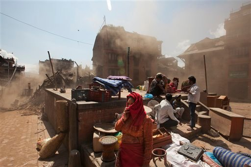 Nepalese residents gather in an open space at the site of destruction caused after Saturday's earthquake in Bhaktapur, on the outskirts of Kathmandu, Nepal, Monday, April 27, 2015. A strong magnitude earthquake shook Nepal's capital and the densely popula