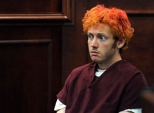 In this July 23, 2012 file photo, James Holmes sits in Arapahoe County District Court in Centennial, Colo. Holmes faces trial starting on April 27, 2015, in the mass shooting in an Aurora, Colo., movie theater that left 12 dead and 70 wounded. (AP Photo/D