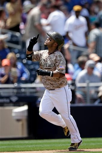 San Diego Padres' Alexi Amarista heads home after hitting a home run against the Los Angeles Dodgers during the third inning of a baseball game Sunday, April 26, 2015, in San Diego. (AP Photo/Gregory Bull)