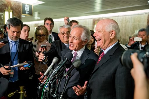 In this April 14, 2015 file photo, Senate Foreign Relations Committee Chairman Sen. Bob Corker, R-Tenn., center, and the committee's ranking member Sen. Ben Cardin, D-Md., right, speak to reporters on Capitol Hill in Washington. Senate proponents of a bi