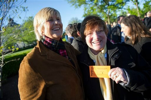 Diane Olson, left, and her wife Robin Tyler, of Los Angeles, show off their number 1 ticket for the first in-line for a seat in the Supreme Court while waiting to enter the court in Washington, Tuesday, April 28, 2015. The Supreme Court is set to hear his