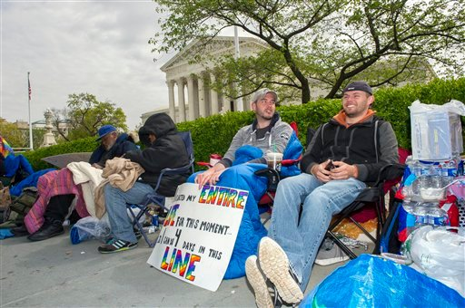 Sean Varsho, 28, of Chicago, left, and Brandon Dawson, 26, of Warrenton Va., have been waiting in line for the past three days for a seat for Tuesday's Supreme Court hearing on gay marriage, Monday, April 27, 2015, in Washington. The opponents of same-sex