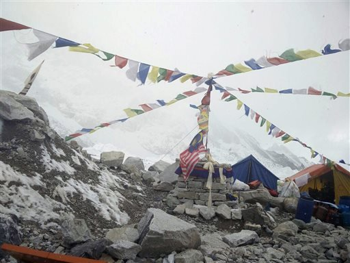 This photo provided by Azim Afif, shows the scene at Everest Base Camp, Nepal on Tuesday, April, 28, 2015. On Saturday, a large avalanche triggered by Nepal's massive earthquake slammed into a section of the Mount Everest mountaineering base camp, killing