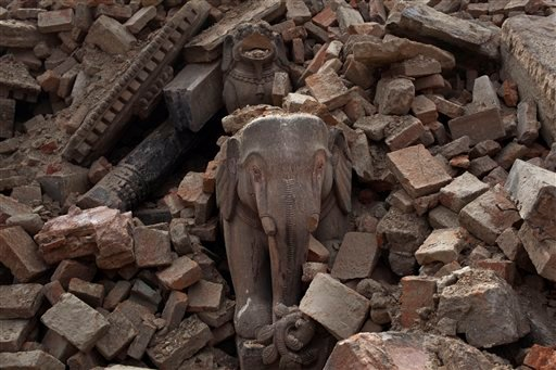 View of the debris of collapsed Bhaktapur Durbar Square after Saturday's earthquake, in Bhaktapur, Nepal, Tuesday, April 28, 2015. Across central Nepal, including in Kathmandu, the capital, hundreds of thousands of people are still living in the open with