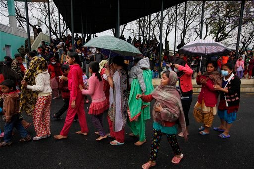 Nepalese victims of an earthquake stand in a queue to receive food in Kathmandu, Tuesday, April 28, 2015. A massive earthquake shook Nepal's capital and the densely populated Kathmandu valley on Saturday leaving hundreds of thousands of people living in t
