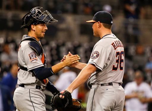 Houston Astros relief pitcher Will Harris and catcher Jason Castro congratulate each other after the Astros 9-4 victory over the San Diego Padres in a baseball game Monday, April 27, 2015 in San Diego. (AP Photo/Lenny Ignelzi))