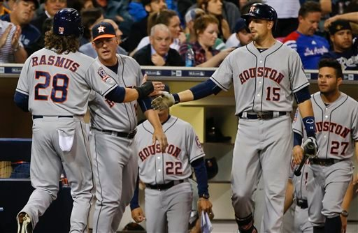 Houston Astros' Colby Rasmus (28) is greeted at the dugout after driving in a run and scoring against the San Diego Padres in the eighth inning of a baseball game Monday, April 27, 2015, in San Diego. (AP Photo/Lenny Ignelzi)