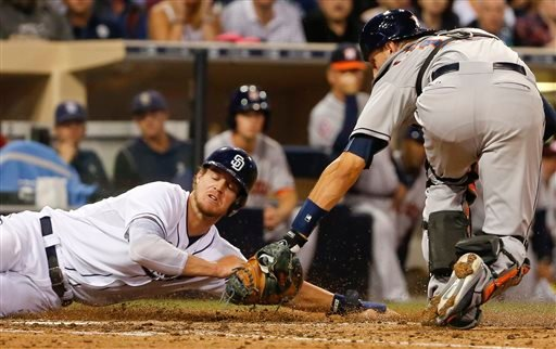 Houston Astros catcher Jason Castro, right, tags out San Diego Padres' Wil Myers at home after Myers tried to score from third on a infield grounder in the seventh inning of a baseball game Monday, April 27, 2015, in San Diego. (AP Photo/Lenny Ignelzi)