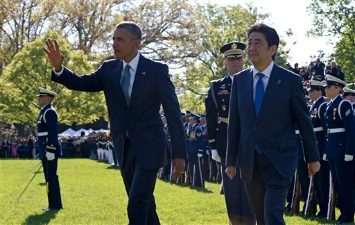President Barack Obama and Japanese Prime Minister Shinzo Abe review the troops during a state arrival ceremony, Tuesday, April 28, 2015, on the South Lawn of the White House in Washington. (AP Photo/Susan Walsh)