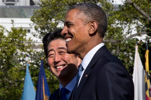 President Barack Obama hosts a state arrival ceremony for Japanese Prime Minister Shinzo Abe, Tuesday, April 28, 2015, on the South Lawn of the White House in Washington. (AP Photo/Jacquelyn Martin)