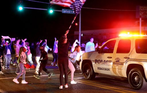 Protesters block the intersection of West Florissant Avenue and Canfield Drive in Ferguson, Mo., Tuesday night, April 28, 2015. (David Carson/St. Louis Post-Dispatch via AP)