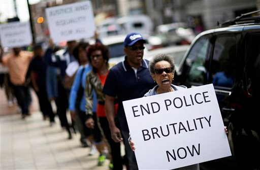Protestors demonstrate outside the State Attorney's office calling for the continued investigation into the death of Freddie Gray April 29, 2015 in Baltimore. (AP Photo/David Goldman)