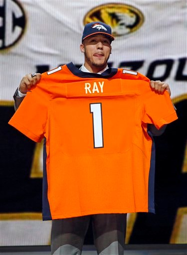 Missouri defensive lineman Shane Ray poses for photos after being selected by the Denver Broncos as the 23rd pick in the first round of the 2015 NFL Draft, Thursday, April 30, 2015, in Chicago. (AP Photo/Charles Rex Arbogast)