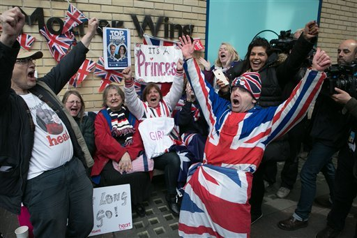 Royal fans and well wishers react after Kensington Palace announced that Kate, the Duchess of Cambridge, had given birth to a girl, outside the Lindo Wing of St. Mary's Hospital, London, Saturday, May 2, 2015.