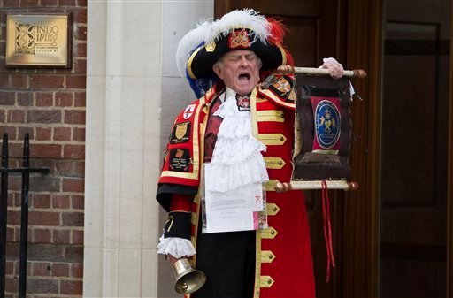 Tony Appleton, a town crier, announces the birth of the royal baby outside the Lindo Wing, St. Mary's Hospital, London, Saturday, May 2, 2015.