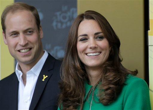 In this Saturday, July 5, 2014 file photo Kate, Duchess of Cambridge and Prince William watch the podium ceremony of the first stage of the Tour de France cycling race in Harrogate, England.