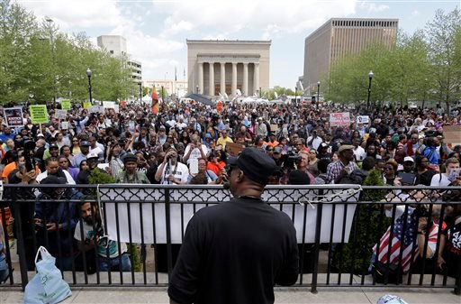"""Cephus """"Bobby"""" Johnson, bottom center, uncle of Oscar Grant, addresses marchers outside Baltimore City Hall, Saturday, May 2, 2015, in Baltimore. Six police officers were charged Friday with felonies ranging from assault to murder in Gray's death. In anno"""