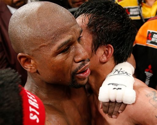 Floyd Mayweather Jr., left, and Manny Pacquiao, from the Philippines, embrace in the ring at the finish of their welterweight title fight on Saturday, May 2, 2015 in Las Vegas.