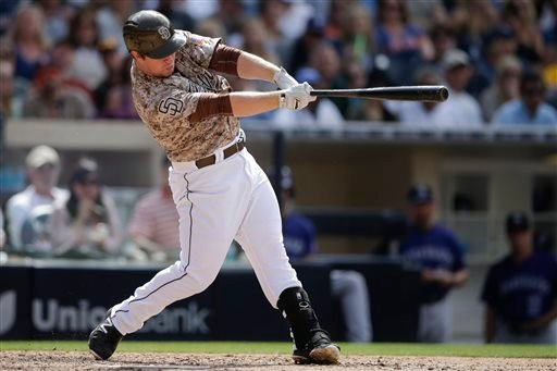 San Diego Padres' Jedd Gyorko hits a two-run home run against the Colorado Rockies during the sixth inning of a baseball game Sunday, May 3, 2015, in San Diego. (AP Photo/Gregory Bull)