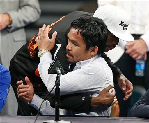 Manny Pacquiao is embraced by Floyd Mayweather Jr. during a press conference following their welterweight title fight on Saturday, May 2, 2015 in Las Vegas.