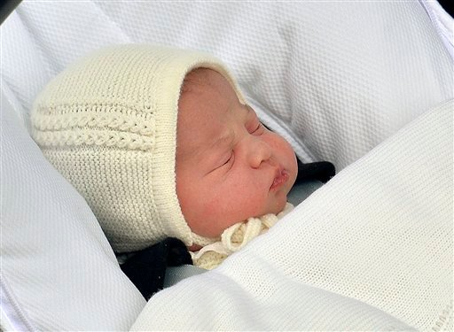The newborn baby princess, born to parents Kate Duchess of Cambridge and Prince William, is carried in a car seat by her father from The Lindo Wing of St. Mary's Hospital, in London, Saturday, May 2, 2015.