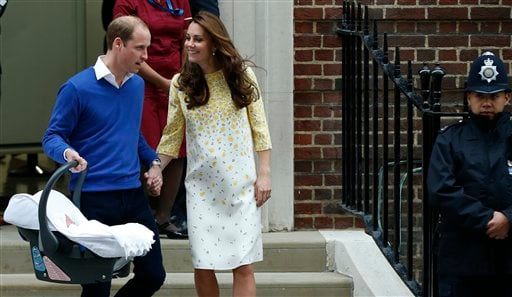Britain's Prince William, left, and Kate, Duchess of Cambridge, hold their newborn daughter as they as they leave St. Mary's Hospital's exclusive Lindo Wing.