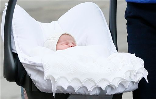 Britain's Prince William and Kate, Duchess of Cambridge, hold their newborn daughter as they as they pose for the media outside St. Mary's Hospital.