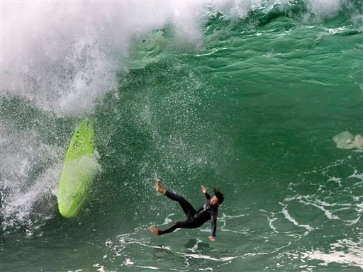 A person surfs at the Wedge in Newport Beach, Calif., Monday, May 4, 2015.