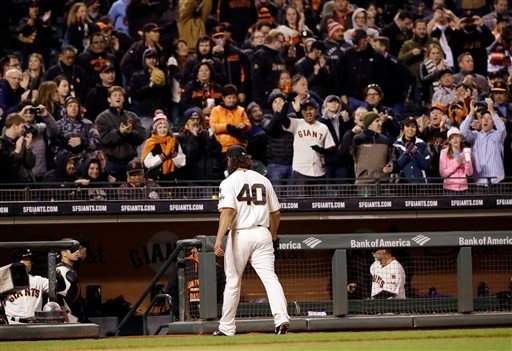 San Francisco Giants starting pitcher Madison Bumgarner gets a standing ovation after losing a no-hit bid to the San Diego Padres in the seventh inning of a baseball game Monday, May 4, 2015, in San Francisco. (AP Photo/Marcio Jose Sanchez)