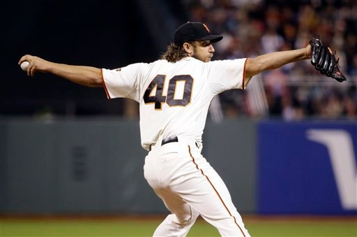San Francisco Giants starting pitcher Madison Bumgarner throws to the San Diego Padres during the fourth inning of a baseball game Monday, May 4, 2015, in San Francisco. (AP Photo/Marcio Jose Sanchez)