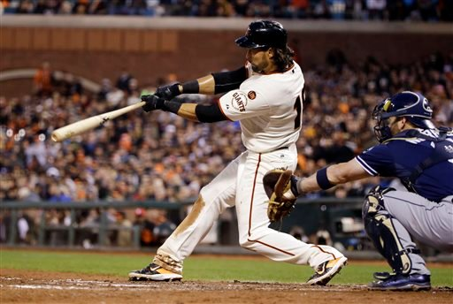 San Francisco Giants' Angel Pagan drives in a run with a single against the San Diego Padres during the third inning of a baseball game Monday, May 4, 2015, in San Francisco. (AP Photo/Marcio Jose Sanchez)