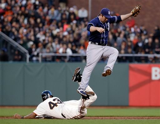San Francisco Giants' Justin Maxwell (43) steals second base as San Diego Padres second baseman Jedd Gyorko reaches for a high throw from the plate during the second inning of a baseball game Monday, May 4, 2015, in San Francisco. (AP Photo/Marcio Jose Sa