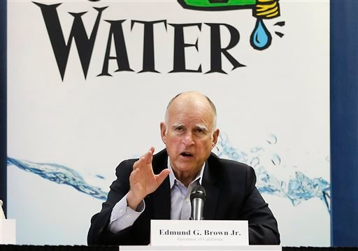 April 16, 2015 file photo: California Gov. Jerry Brown talks with reporters after a meeting about the drought at his Capitol office in Sacramento, Calif. (AP Photo/Rich Pedroncelli, File)