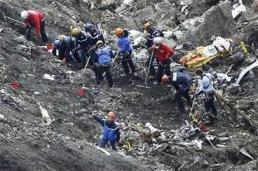 In this March 26, 2015 file photo, rescue workers work on debris of the Germanwings jet at the crash site near Seyne-les-Alpes, France. (AP Photo/Laurent Cipriani, File)