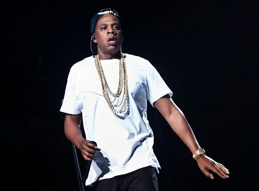 In this Oct. 10, 2013 file photo, U.S singer Jay-Z performs on stage at the O2 arena in London, as part of his Magna Carta World Tour.