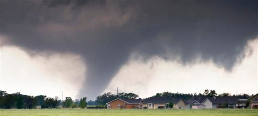 A tornado passes near Halstead, Kan., Wednesday, May 6, 2015. A swath of the Great Plains is under a tornado watch Wednesday, including parts of North Texas, Oklahoma, Kansas and Nebraska. (Travis Heying/The Wichita Eagle via AP)