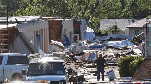 People look through rubble, Thursday, May 7, 2015, in an area damaged by severe weather a day earlier, in Oklahoma City. (AP Photo/Sue Ogrocki)