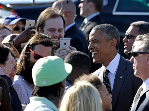 President Barack Obama smiles as he greets people in Portland, Ore., Thursday, May 7, 2015. On Friday, the president will visit Nike headquarters in Beaverton, Ore., to make his trade policy pitch as he struggles to win over Democrats for what could be th