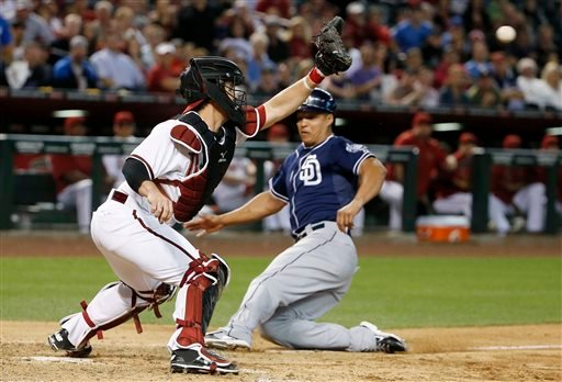 San Diego Padres' Will Venable slides into home plate to score a run as Arizona Diamondbacks' Tuffy Gosewisch, left, waits for a late throw during the fourth inning of a baseball game Friday, May 8, 2015, in Phoenix. (AP Photo/Ross D. Franklin)