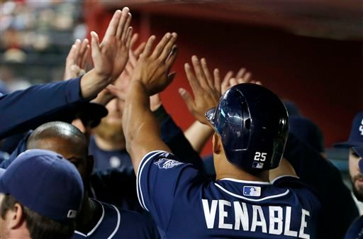 San Diego Padres' Will Venable, right, celebrates his run scored against the Arizona Diamondbacks during the fourth inning of a baseball game Friday, May 8, 2015, in Phoenix. (AP Photo/Ross D. Franklin)