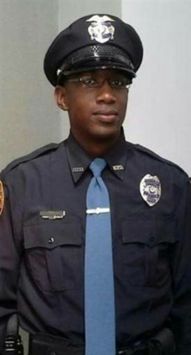 This undated photo released by the Hattiesburg Police Department, shows Officer Liquori Tate in Hattiesburg, Miss. Officer Tate and Officer Benjamin Deen were fatally shot during a traffic stop, Saturday evening, May 9, 2015, in the southern Mississippi c