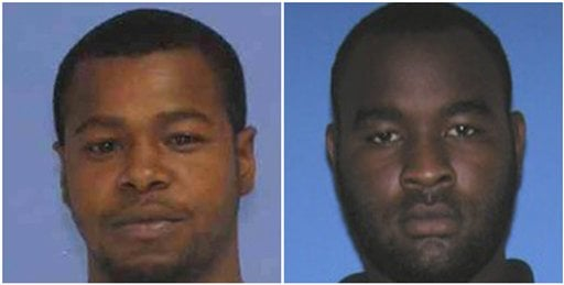 This combination of undated photos released the Mississippi Bureau of Investigation shows, Marvin Banks, left, and his brother Curtis Banks. The brothers are wanted in the fatal shooting of two Hattiesburg, Miss., police officers on Saturday, May 9, 2015.