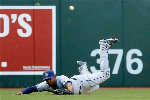 San Diego Padres left fielder Justin Upton can't catch an RBI triple by Arizona Diamondbacks' David Peralta during the fourth inning of a baseball game, Saturday, May 9, 2015, in Phoenix. (AP Photo/Matt York)