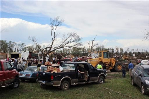Dozens of people gather to help with cleanup efforts at a farm that was severely damaged by a tornado Sunday, May 10, 2015, in Delmont, S.D. South Dakota was the center of weather extremes Sunday, with a tornado hitting the small town on the eastern side