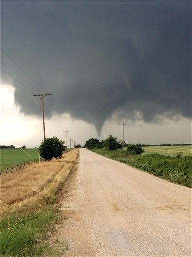 In this Saturday, May 9, 2015 photo provided by Brian Khoury, a tornado touches down in Cisco, Texas. One person was killed Saturday night and another left in critical condition after the tornado hit Cisco, a rural farming and ranch area about 100 miles w